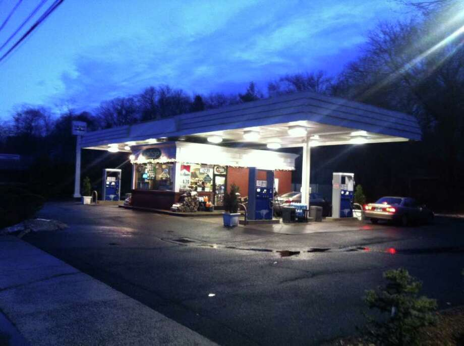 The Exxon station on Post Road in Darien was robbed by three masked men late Monday night, Jan. 23, 2012, police said. Photo: John Nickerson