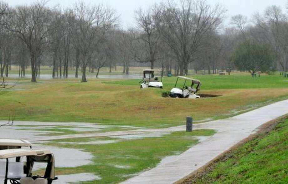 Golf carts were driven near a green and into a sand trap on Pecan Grove Country Club's golf course on Jan. 9, 2012. Photo: Fort Bend Co. Sheriff's Office