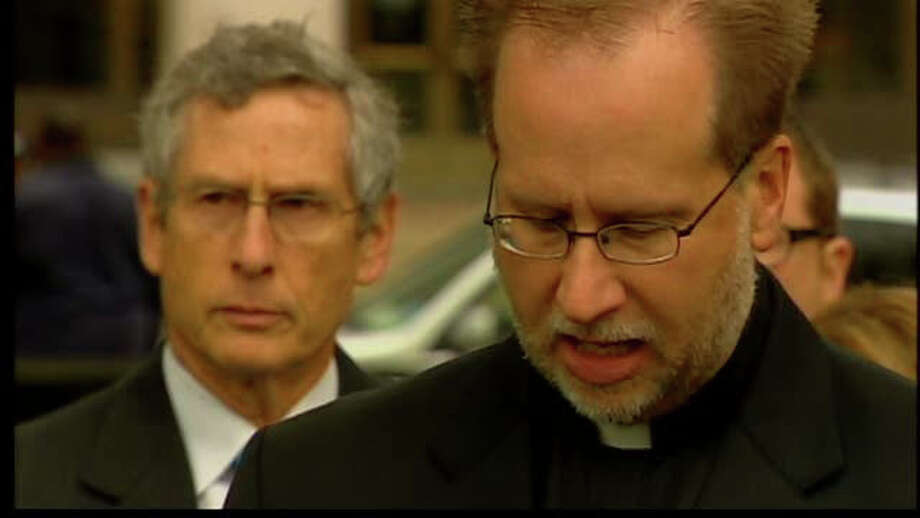 Father James Manship, pastor of St. Rose of Lima Church in New Haven, talks about his arrest while videotaping an East Haven police raid at Chacon's store in 2009. Photo: WTNH