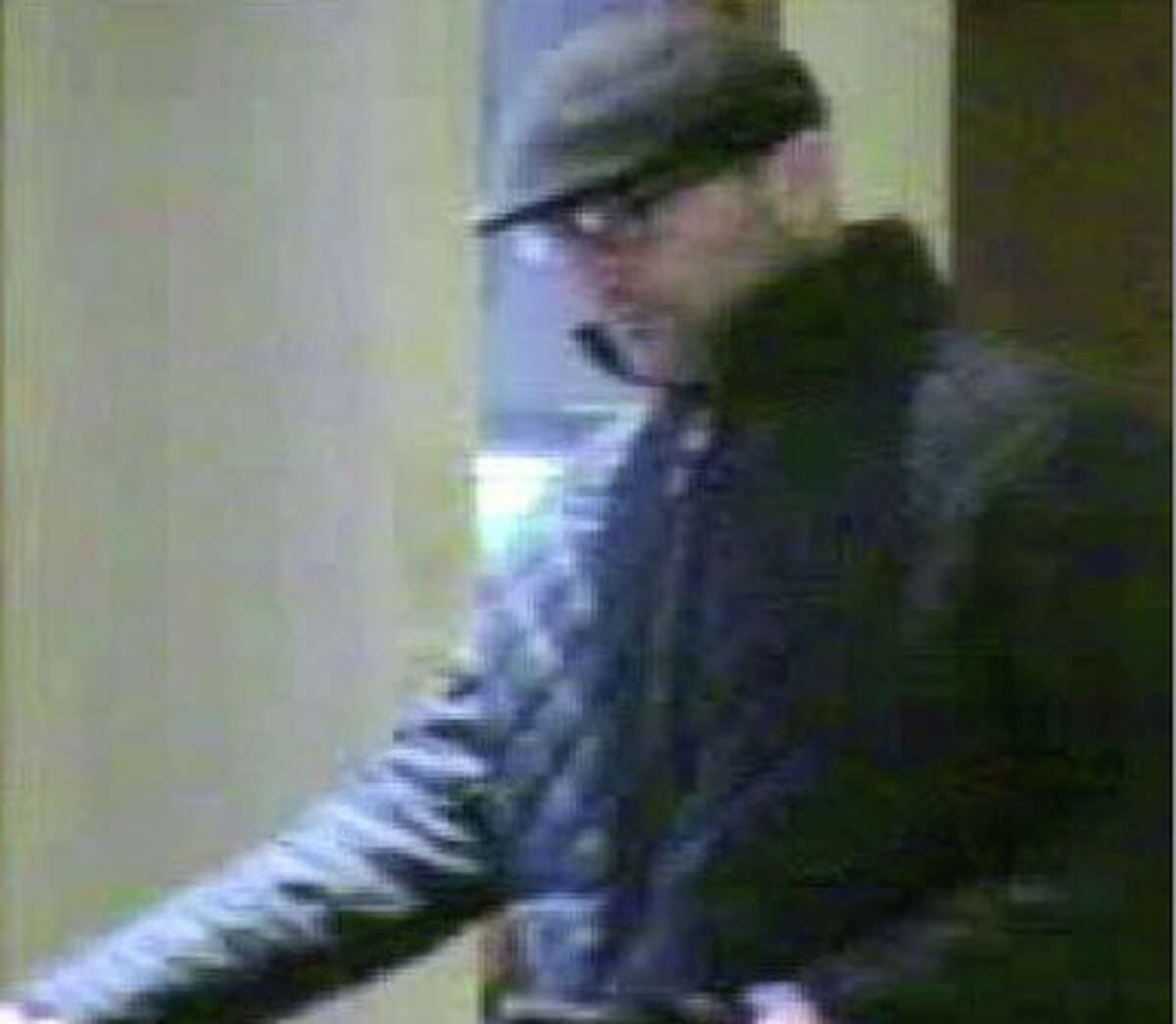 """Surveillance image of the suspect in the killing of Westport jeweler Yekutiel Zeevi on Dec 8, 2011. Federal authorities have charged Andrew Robert Levene, also known as """"Robert Thomas"""", 41, was arrested in Spain on federal murder, robbery and firearm charges in connection with the killing of Yekutiel Zeevi, a Westport jewelry manufacturer inside his store last month."""