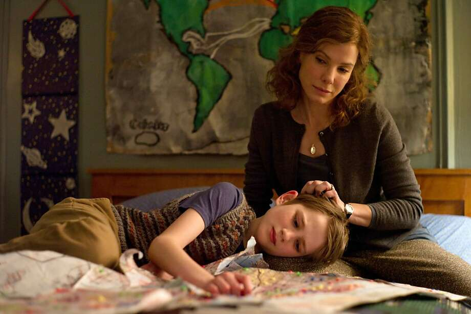 """In this image released by Warner Bros. Pictures, Thomas Horn portrays as Oskar Schell and Sandra Bullock portrays Linda Schell in a scene from """"Extremely Loud & Incredibly Close ."""" The film was nominated Tuesday, Jan. 24, 2012 for an Oscar for best film. The Oscars will be presented Feb. 26 at the Kodak Theatre in Los Angeles, hosted by Billy Crystal and broadcast live on ABC. (AP Photo/Warner Bros. Pictures, François Duhamel) Photo: François Duhamel, Associated Press"""