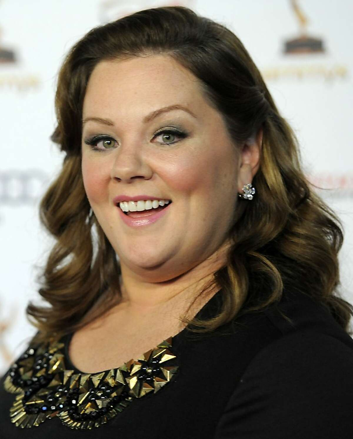 """FILE - In this Sept. 16, 2011 file photo, Melissa McCarthy poses at the 63rd Primetime Emmy Awards Performers Nominee Reception in Los Angeles. McCarthy was nominated Tuesday, Jan. 24, 2012 for an Academy Award for best supporting actress for her role in """"Bridesmaids."""" (AP Photo/Chris Pizzello, file)"""