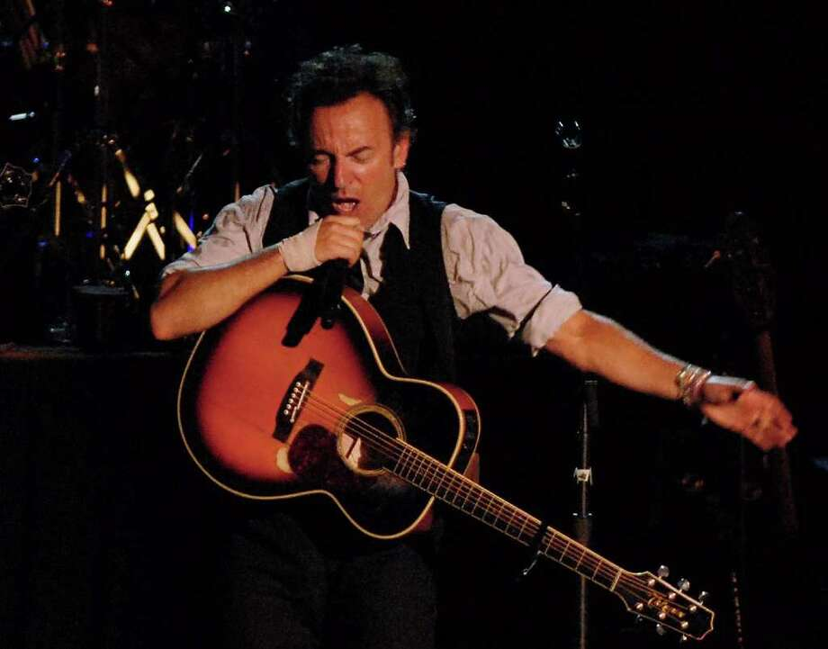 Bruce Springsteen and members of the Seeger Sessions Band perform at SPAC to a huge crowd on June 19, 2006.  (Luanne M. Ferris / Times Union Archive) Photo: LMF, DG / ALBANY TIMES UNION