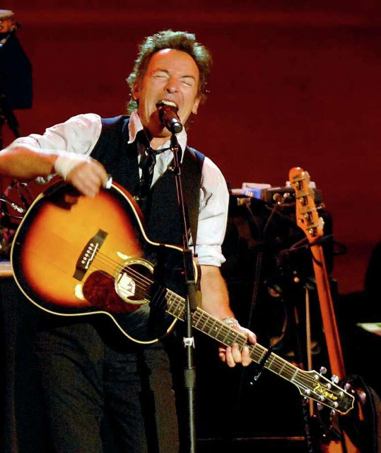 Bruce Springsteen and members of the Seeger Sessions Band perform at  SPAC to a huge crowd on June 19, 2009. (Luanne M. Ferris / Times Union  Archive) Photo: LMF, DG / ALBANY TIMES UNION