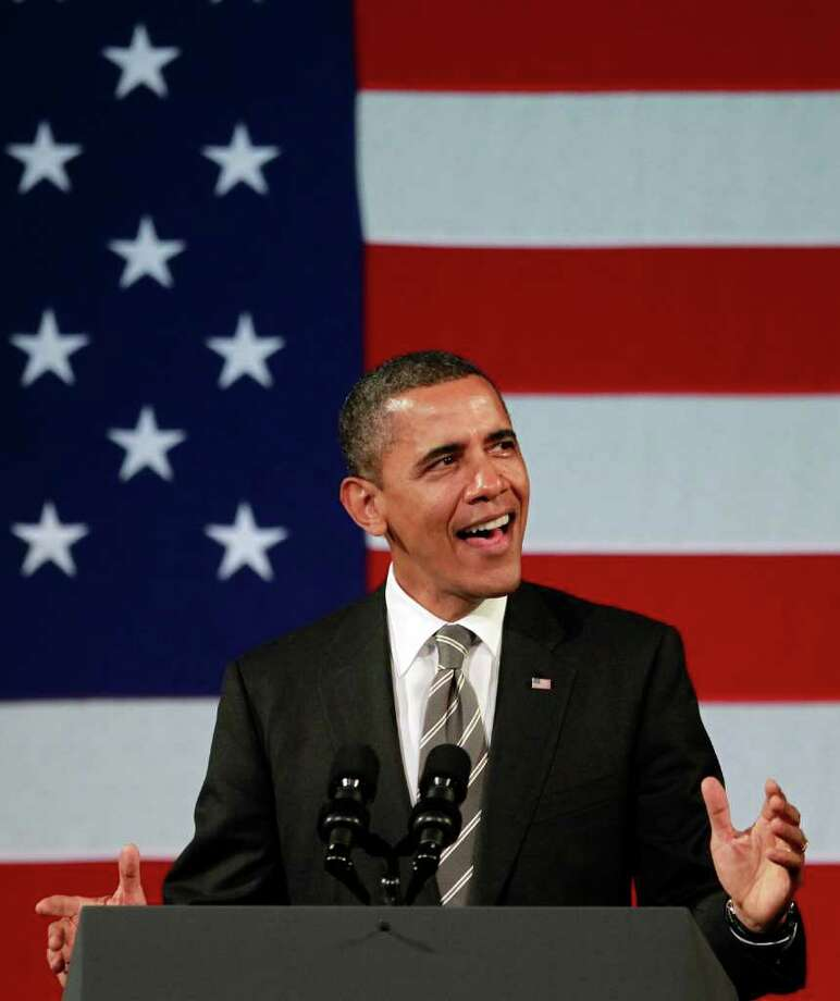 President Barack Obama croons an Al Green tune in Harlem, his all-business demeanor vanishing for a while.  Photo: Associated Press, Haraz N. Ghanbari