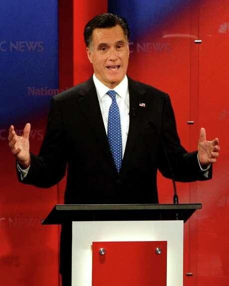 Republican presidential candidate, former Massachusetts Gov. Mitt Romney gestures during a Republican presidential debate Monday Jan. 23, 2012, at the University of South Florida in Tampa, Fla. (AP Photo/Paul Sancya) Photo: Paul Sancya / AP