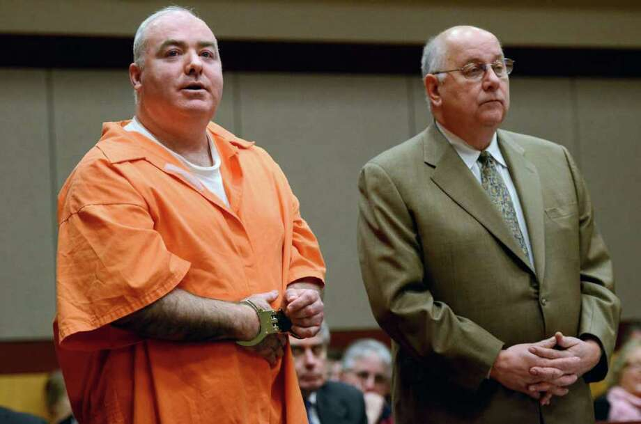 Michael Skakel, left, addresses the court with attorney his Hubert Santos in Middletown Tuesday, Jan. 24, 2012. Skakel is seeking a reduction in his sentence of 20 years to life in prison for killing his neighbor Martha Moxley in Greenwich. (AP Photo/Jessica Hill, Pool) Photo: Jessica Hill, Associated Press / AP2012