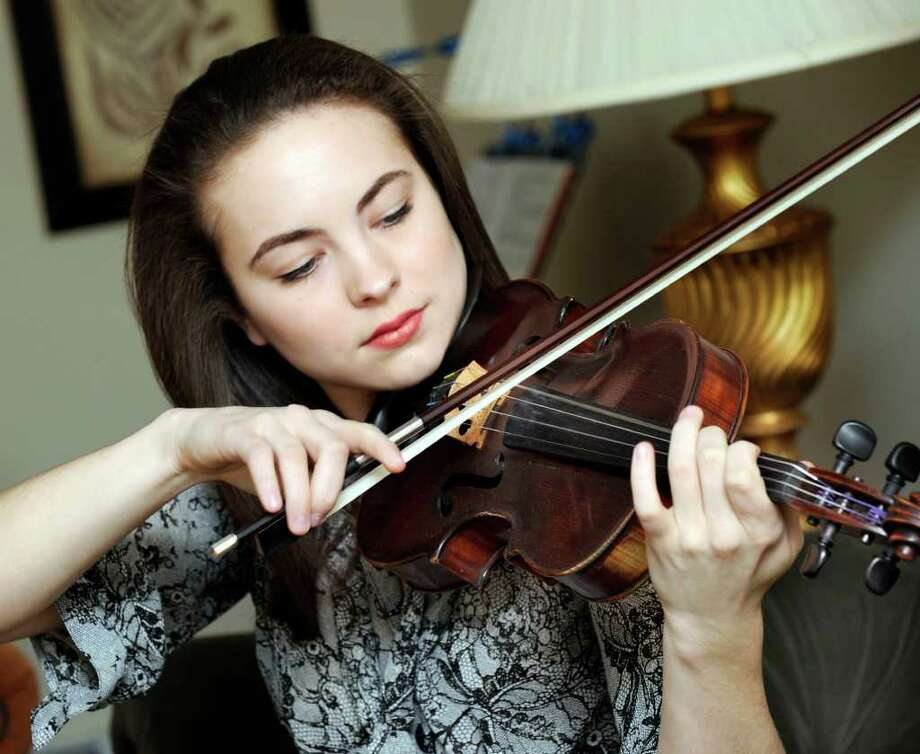 Zoe Miller, 18, a senior at Brookfield High School, will represent Connecticut in the Distinguished Young Women contest in Alabama in June. She will perform a classical piece on the violin during the talent portion of the competition. Photo taken Monday, January 23, 2012. Photo: Carol Kaliff / The News-Times