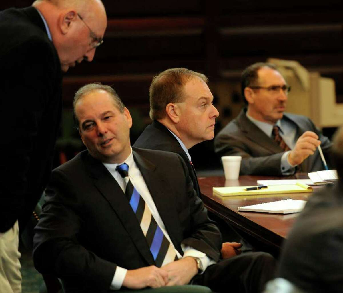 From left, attorneys Michael Feit and Brian Premo speak at the Rensselear County Courthouse in Troy, N.Y. Jan. 24, 2012, in the ballot fraud case of their respective clients, Michael LoPorto, right, and Edward McDonough. (Skip Dickstein / Times Union archive)