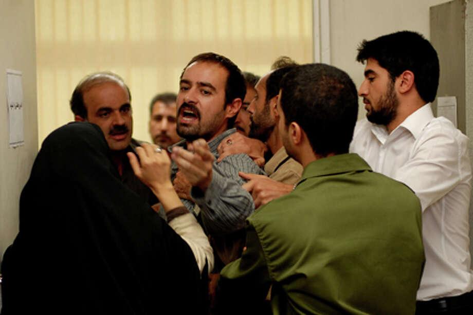 "Shahab Hosseini (center) as Hodjat in ""A Separation."""