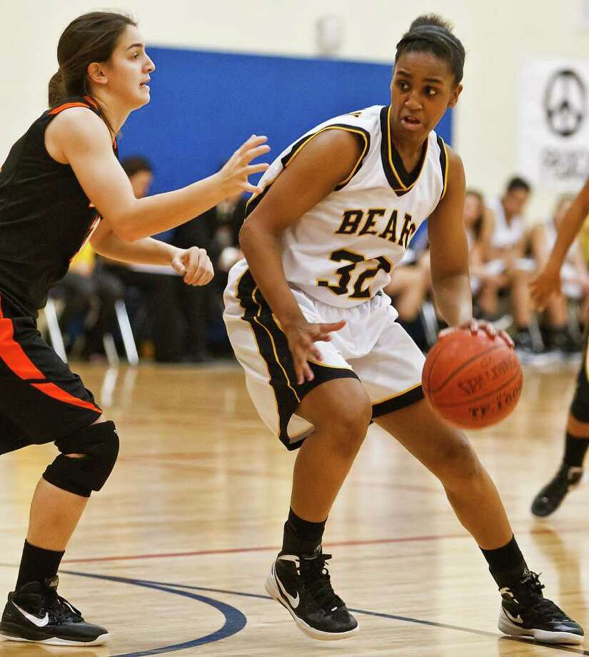 Brennan's sophomore post Tanaeya Boclair (right) looks to drive the ball past Medina Valley's Karlyn Williams during their game at the Brennan gym on Jan. 20.  Photo by Marvin Pfeiffer Photo: MARVIN PFEIFFER, Marvin Pfeiffer / Prime Time Newspapers / Prime Time Newspapers 2012