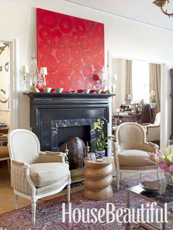 "Decorate With What You LoveWhen painter and stylist Craig Schumacher moved from a 10-room Dallas house into a four-room apartment, it didn't hamper his style. His decorating look became layer upon layer: ""I bought things I knew I'd never tire of, and I've found out that if you love something, you'll find a place for it."" His living room is furnished with antiques and vintage pieces, including a faux fireplace added for its architectural interest. Nathan Schroder"
