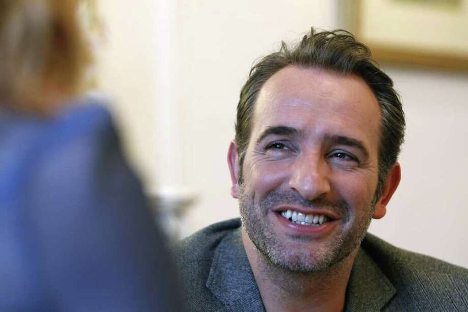 French actor Jean Dujardin addresses reporters during an interview with the Associated Press in Paris, Tuesday, Jan. 24, 2012. The movie, 'The Artist', in which Jean Dujardin plays main role, is nominated 10 times for the Oscar, amongst them writing and directing nominations for French filmmaker Michel Hazanavicius, a best-actor honor for Jean Dujardin and a supporting-actress nod for Berenice Bejo. (AP Photo/Remy de la Mauviniere) Photo: Remy De La Mauviniere / AP