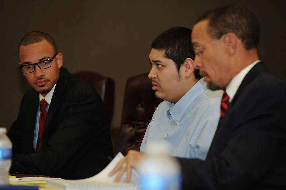Jonathan Benitez, center, talks with his attorney Sean Villery-Samuel at the beginning of his trial for the death of a 16-year-old Mandy Le in 2011.  Photo taken Tuesday, January 24, 2012 Guiseppe Barranco/The Enterprise Photo: Guiseppe Barranco, STAFF PHOTOGRAPHER / The Beaumont Enterprise