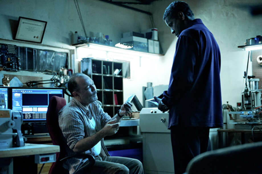 "(L-R) Rubén Blades and Denzel Washington as Tobin Frost in ""Safe House."" Photo: Jasin Boland / 2012 Universal Pictures"