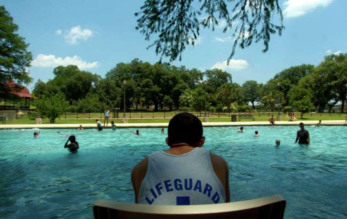 Splash around in an outdoor city pool.