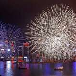Fireworks explode over the Victoria Harbour to celebrate the Chinese Lunar New Year in Hong Kong Tuesday, Jan. 24, 2012.