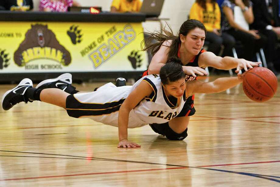 Brennan's Alyssa Crockett (below) fights with Medina Valley's Karlyn Williams for a loose ball during their game at the Brennan gym. The District 28-4A leading Bears bested the Panthers 47-40, with Crockett leading all scorers with 19. Photo by Marvin Pfeiffer Photo: MARVIN PFEIFFER, Marvin Pfeiffer / Prime Time Newspapers / Prime Time Newspapers 2012