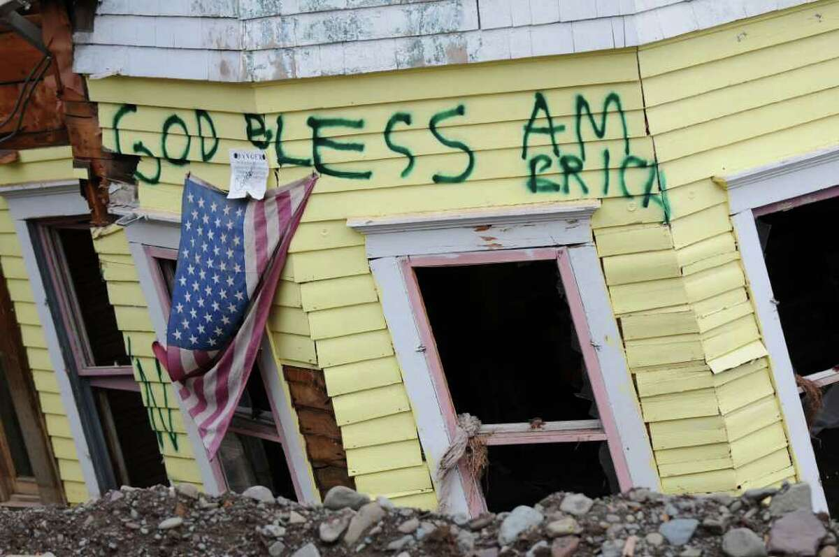View of graffiti on a devastated home on Thursday Nov. 17, 2011 in Prattsville, NY, destroyed by flooding from Tropical Storm Irene. Lawmakers are looking a measure that would let localities float five year bonds to help pay for flood recovery in the wake of Hurricane Irene and Tropical Storm Lee. (Philip Kamrass / Times Union archive )