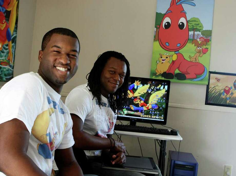 Brothers Antonio, left, and AJ Moore founded GudFit Entertainment. They grew up in San Antonio and craft kid-friendly comic books and Web comics. Photo: HELEN L. MONTOYA, San Antonio Express-News / ©2012 San Antonio Express-News