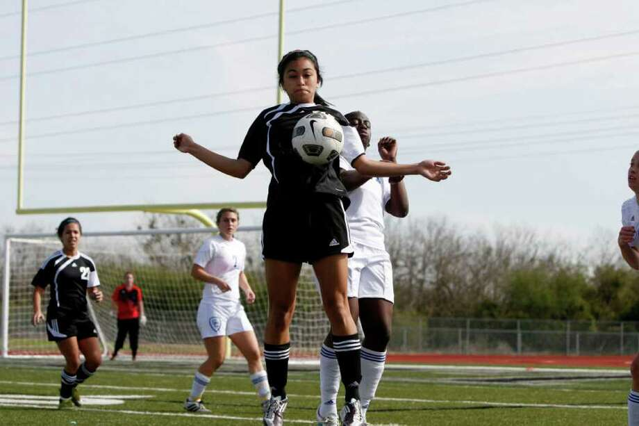 Steele Lady Knight Sabrina Angeles jumps to block the ball during Steele's 2-0 win Saturday over rival Clemens. Photo by Greg Bell Photo: Greg Bell / Northeast Herald