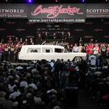 In this photo provided by Barrett-Jackson, the white hearse used to transport President John F. Kennedy's body following his assassination in Dallas is shown at auction Saturdayin Scottsdale, Ariz. It sold for $160,000 to a collector and real estate developer from Boulder, Colo.