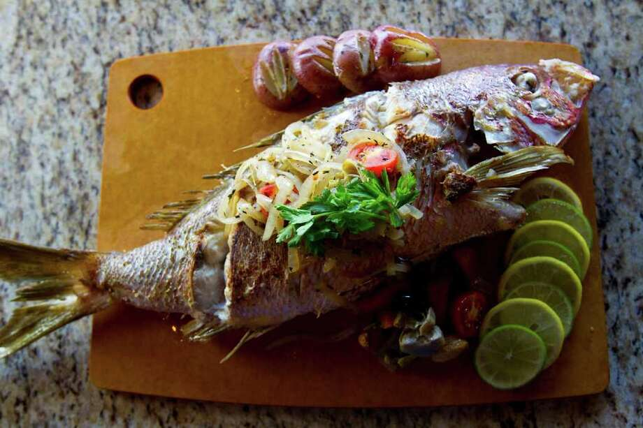 Fish, especially species with a bold flavor, shines with simple preparation. Photo: Karen Warren / © 2011 Houston Chronicle