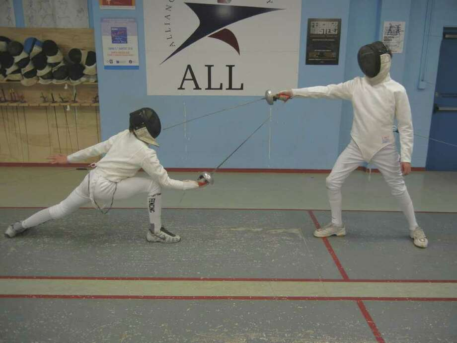 West University Place twins Sean Wilson and brother Nicholas are top fencers in their age bracket. Photo: Handout