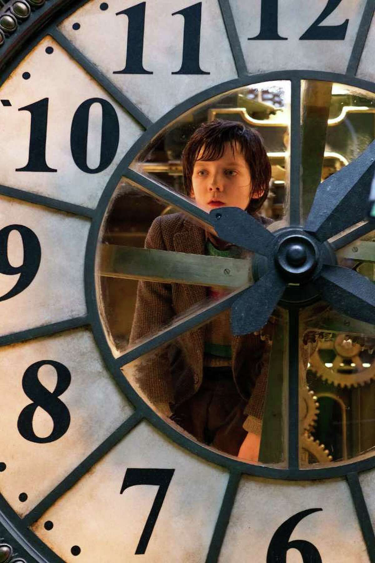 """In this image released by Paramount Pictures, Asa Butterfield portrays Hugo Cabret in a scene from """"Hugo."""" The film was nominated Tuesday, Jan. 24, 2012 for an Oscar for best film. The Oscars will be presented Feb. 26 at the Kodak Theatre in Los Angeles, hosted by Billy Crystal and broadcast live on ABC. (AP Photo/Paramount Pictures, Jaap Buitendijk)"""