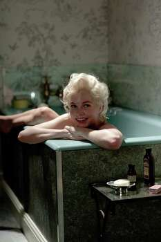 """In this film publicity image released by The Weinstein Company, Michelle Williams portrays Marilyn Monroe in a scene from """"My Week with Marilyn.""""  Williams was nominated Tuesday, Jan. 24, 2012 for an Academy Award for best actress for her role in the film. The Oscars will be presented Feb. 26 at the Kodak Theatre in Los Angeles, hosted by Billy Crystal and broadcast live on ABC. (AP Photo/The Weinstein Company, Laurence Cendrowicz) Photo: Laurence Cendrowicz"""