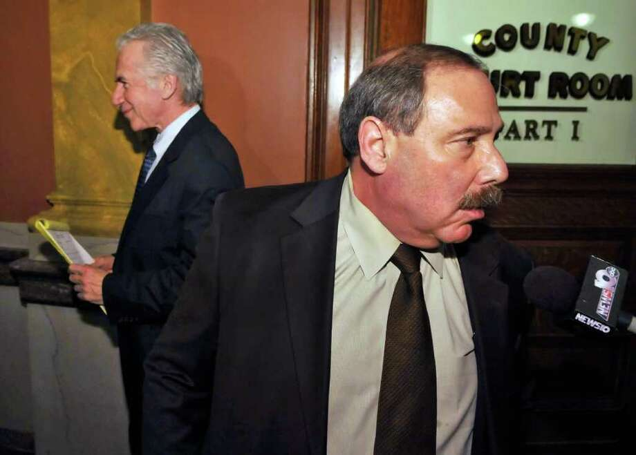 Defense attorney Brian Donohue, left, and Special Prosecutor Robert Becher leave the courtroom as the jury is retired for the day in George Mott III's trial in Troy Tuesday Jan. 24, 2012.   (John Carl D'Annibale / Times Union) Photo: John Carl D'Annibale