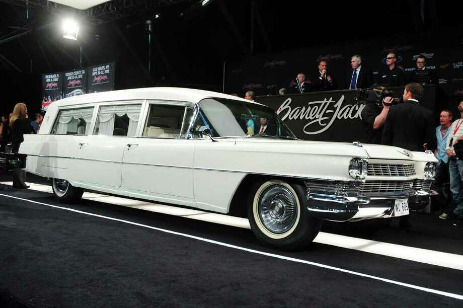 In this photo provided by Barrett-Jackson, the white hearse used to transport President John F. Kennedy's body following his assassination in Dallas is shown at auction Saturday, Jan. 21, 2012 in Scottsdale, Ariz. It sold for $160,000 to a collector and real estate developer from Boulder, Colo.  (AP Photo/ Barrett-Jackson)   / Barrett-Jackson