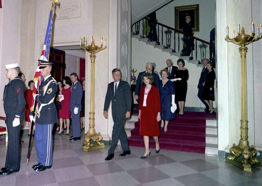 This Nov. 20, 1963 photo released by the John F. Kennedy Presidential Library and Museum in Boston, shows President John F. Kennedy, First Lady Jacqueline Kennedy, Chief Justice Earl Warren, Mrs. Warren, and others descending the Grand Staircase during the Judicial Reception at the White House, in Washington.  On Tuesday, Jan. 24, 2012, the Kennedy Llibrary will release the final 45 hours of White House recordings secretly taped during President Kennedy?s time in office. The last tapes were made on Nov. 20, 1963, two days before his assassination in Dallas. (AP Photo/The White House, Cecil Stoughton) Photo: Cecil Stoughton / The White House