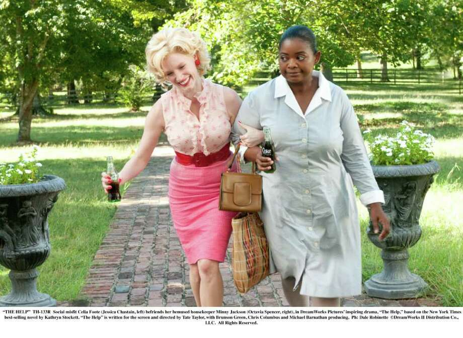 """""""THE HELP"""" - TH-133R - Social misfit Celia Foote (Jessica Chastain, left) befriends her bemused housekeeper Minny Jackson (Octavia Spencer, right), in DreamWorks Pictures' inspiring drama, """"The Help,"""" based on the New York Times best-selling novel by Kathryn Stockett. """"The Help"""" is written for the screen and directed by Tate Taylor, with Brunson Green, Chris Columbus and Michael Barnathan producing. Ph: Dale Robinette DreamWorks II Distribution Co., LLC.  All Rights Reserved. Photo: Dale Robinette / ©DreamWorks II Distribution Co., LLC.  All Rights Reserved."""
