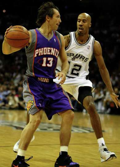 Spurs Bruce Bowen defends Suns Steve nash during first half action in the Western Conference semifin
