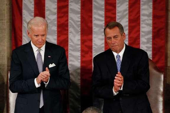 Vice President Joe Biden and House Speaker John Boehner applaud President Barack Obama on Capitol Hill.