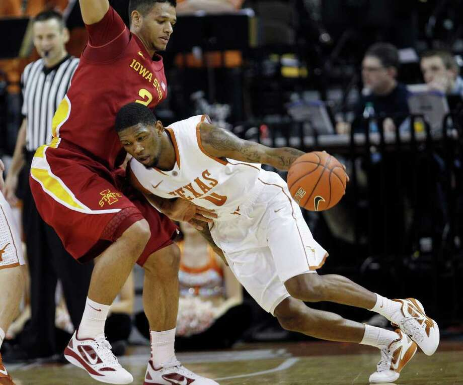 Texas' Julien Lewis, right, is defended by Iowa State's Chris Babb, left, during the first half of an NCAA college basketball game, Tuesday, Jan. 24, 2012, in Austin, Texas. (AP Photo/Eric Gay) Photo: Eric Gay, Associated Press / AP
