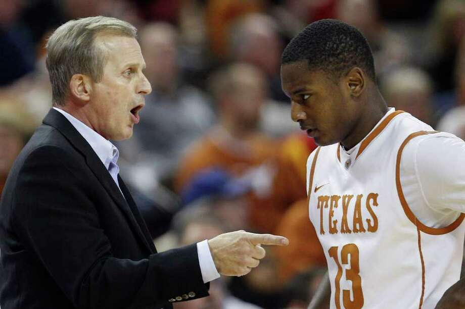 Texas coach Rick Barnes, left, talks with Sterling Gibbs during the first half of an NCAA college basketball game against Iowa State, Tuesday, Jan. 24, 2012, in Austin, Texas. (AP Photo/Eric Gay) Photo: Eric Gay, Associated Press / AP