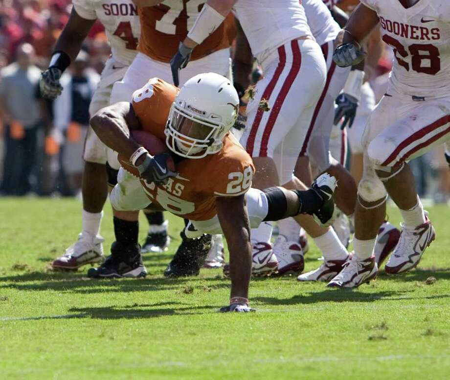 Texas running back Fozzy Whittaker fights for yardage during the second half of The University of Texas and Oklahoma University's match-up in the Red Rivalry at the Cotton Bowl at the State Fair of Texas, in Dallas Texas ,October 17, 2009.  (BILLY SMITH II /CHRONICLE) Photo: Billy Smith II / Houston Chronicle