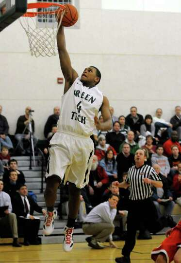Green Tech's Lewis Jackson goes in for a basket during their high school boys basketball game agains