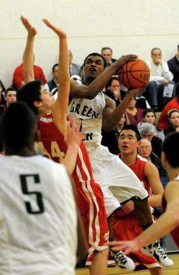 Green Tech's Rasual Ali goes in for a basket during their high school boys basketball game against N
