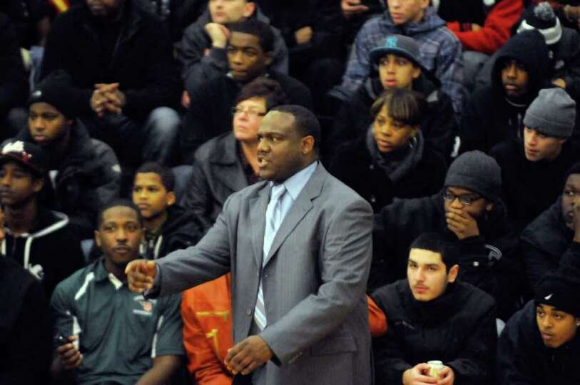 Green Tech's head coach Jamil L. Hood Sr. during their high school boys basketball game against Nisk