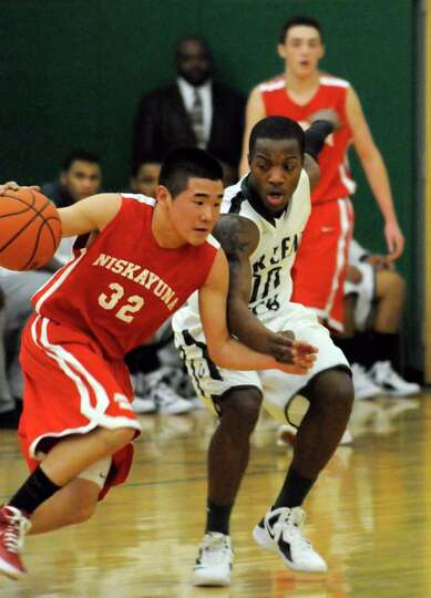 Niskayuna's Connor Andrews is guarded by Green Tech's Maurice West  during their high school boys ba