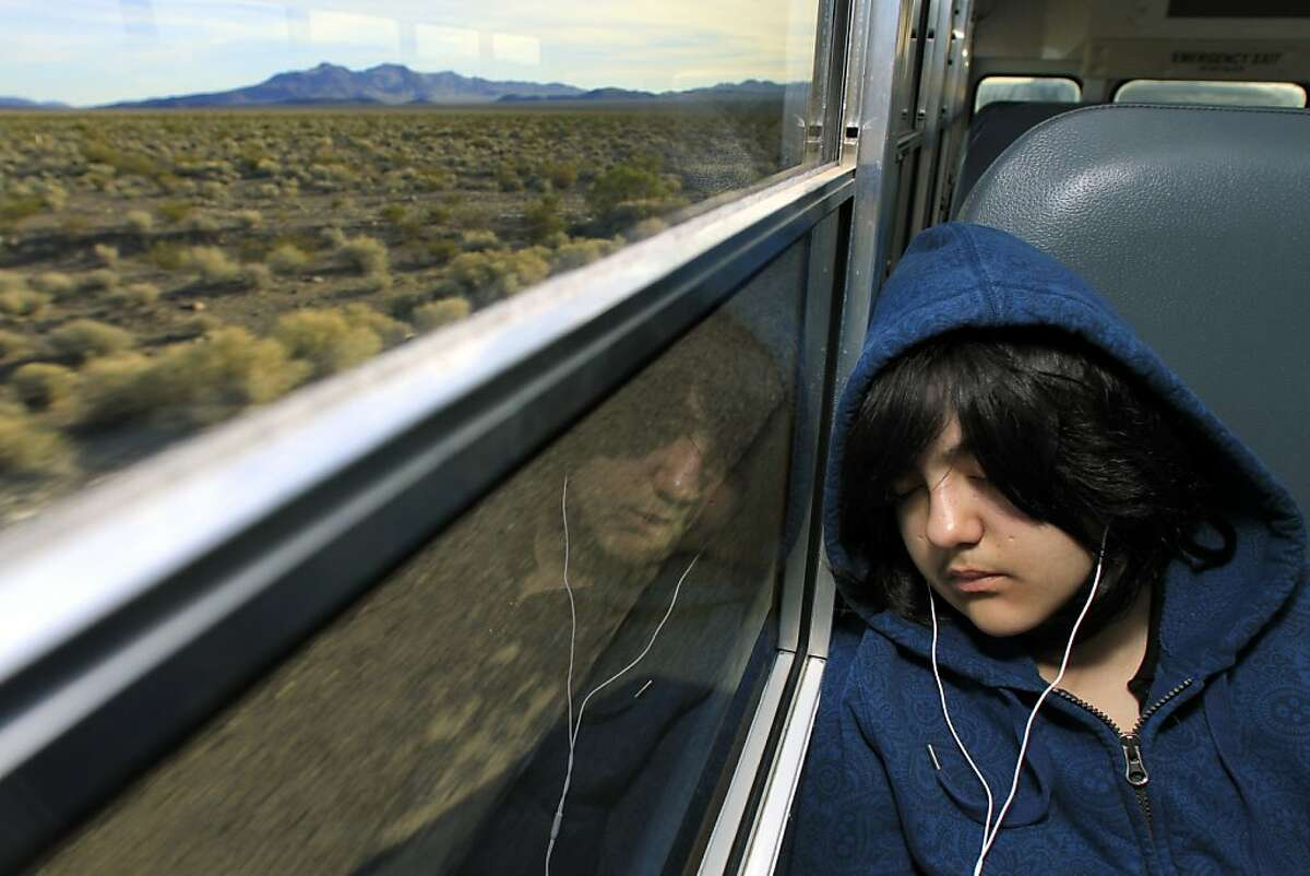 SHOSHONE, CA. January 10, 2012 --- Diannet Lujano, 15, who lives in Furnace Creek, Death Valley, takes nap on a long drive home on a school bus from Death Valley High school in Shoshone. (Irfan Khan/Los Angeles Times.)
