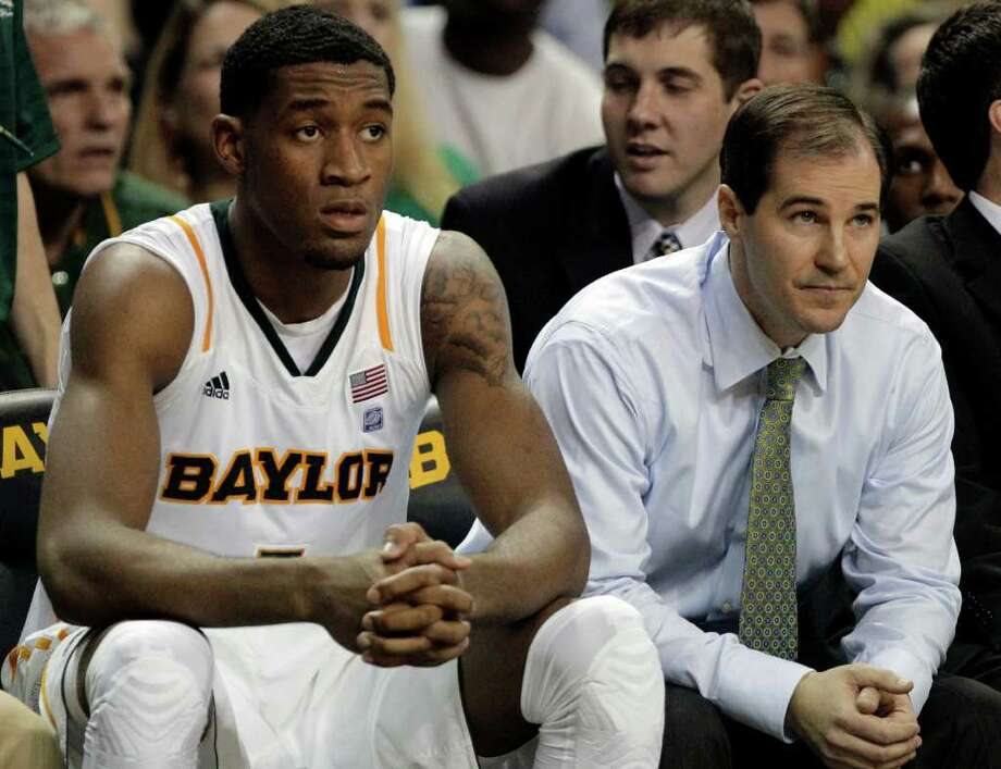 Baylor's Perry Jones III, left, and head coach Scott Drew, right, look on late in the second half of an NCAA college basketball game against Missouri  onSaturday, Jan. 21, 2012, in Waco, Texas. Missouri won 89-88. (AP Photo/Tony Gutierrez) Photo: Tony Gutierrez / AP
