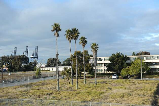 An old building is seen at the former Oakland Army base on January 18, 2012. The base has been closed since 1996. Oakland is set to develop the old base into industrial facilities for the Port. Many buildings have already been demolished. Photo: Susana Bates, Special To The Chronicle
