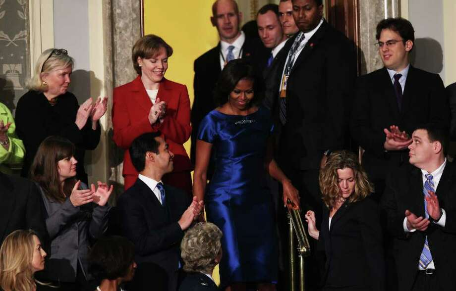 San Antonio Mayor Julián Castro joins other guests Tuesday night in applauding first lady Michelle Obama as she arrives to take her seat before her husband's State of the Union address to a joint session of Congress. Photo: Getty Images, Win McNamee / 2012 Getty Images