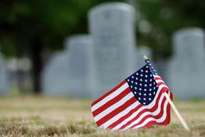 An American flag is tilted into the grass at Houston's Veterans Memorial Cemetery in Houston, Texas, Tuesday, Jan. 24, 2012.  A review of cemeteries administered by the Department of Veterans Affairs has revealed problems with 123 gravesites, including eight cases in which people were buried in the wrong gravesite. The other mistakes consisted primarily of headstones and markers that were incorrectly moved to the wrong gravesites during renovation projects, generally one grave space away from where they were supposed to be.  (AP Photo/Pat Sullivan)