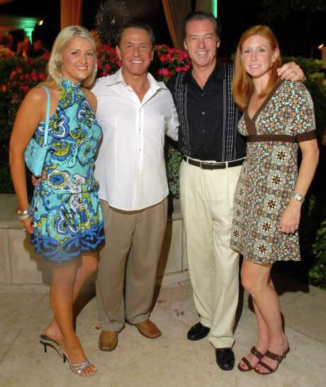 Kelly Cripe, from left, Bob Allen, Bob Boudreaux and Jennie Moroney at a birthday party for Tillman Fertitta at Fertitta's home Friday June 22,2007.(Dave Rossman/For the Chronicle) Photo: Dave Rossman / Freelance