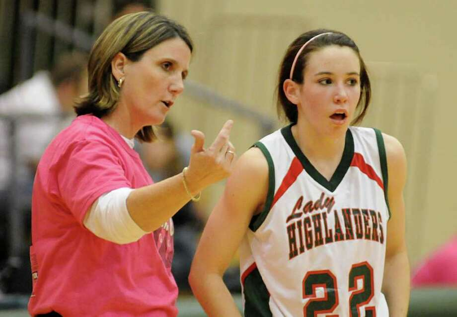 The Woodlands' coach Dana Bruton talks to Paige Bradley during the College Park at The Woodlands girls basketball game. Photo: David Hopper / freelance